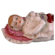 """Baby in a Bunting"" Porcelain Fairing Box"