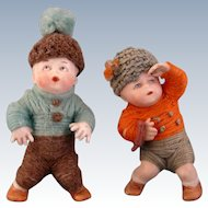 Pair of Heubach Position Babies with Original Factory Yarn Clothes