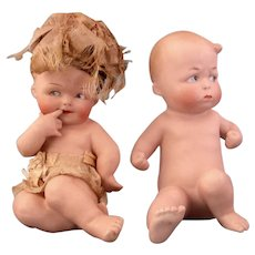 """Pair of Heubach Piano Babies """"Shy Girl ( with original clothes) and Angry Boy"""""""