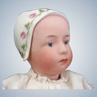 "Gebruder Heubach German ""Baby Stuart"" Molded bonnet bisque Doll"