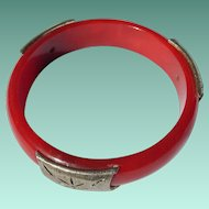 Metal Mounted Red Bakelite Bangle Bracelet