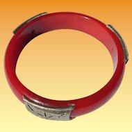 Metal Mounted Red Bakelite Bangle Bracelet
