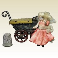 "Antique All Bisque Miniature 2"" Doll House Doll and Fischer Penny Toy Pram Carriage German Circa 1910"