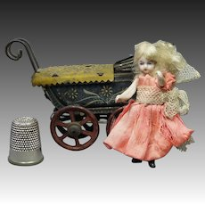 """Antique All Bisque Miniature 2"""" Doll House Doll and Fischer Penny Toy Pram Carriage German Circa 1910"""