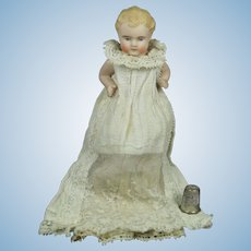 "Antique Quality 5"" German Bisque Seated Baby, Jointed Arms, Exceptionally Fine Features, Original Antique Dress Circa 1890"