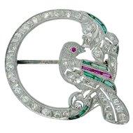 Charming Art Deco Diamond Ruby Emerald Sapphire Filigree Bird Brooch in Platinum