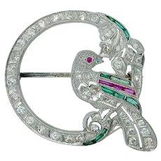 Charming Art Deco Diamond Ruby Emerald Sapphire Filigree Bird Brooch in Platinum