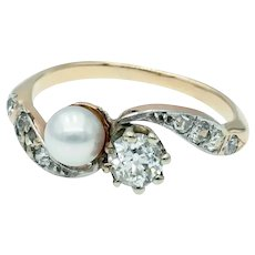 Graceful Antique Edwardian Moi et Toi Crossover Diamond and Natural Pearl Ring in 14k White Topped Yellow Gold