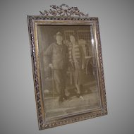 Small Brass Tabletop Picture Frame with Bow and Wreath Garland at Top