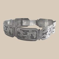 Guatemalan 900 Silver Bracelet with Mayan Imagery stands out in sharp relief