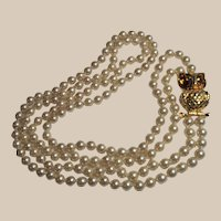 Thirty Inch Double Strand of Glass Pearls With Large Owl Clasp