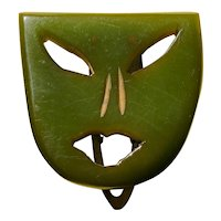 Wonderful Carved Green Bakelite Dress Clip in the form of a Mask  circa 1930s - 1940s