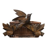 Unusual Black Forest Carved Wooden Bird on a Basket