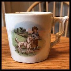 A Boy and his Poodle Child's Mug - Porcelain Circa 1910