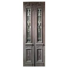 """Salvaged Pair of 34"""" Antique Figural Doors with Iron Inserts"""
