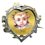 Pin--Early 20th C. Hand Painted Porcelain Surprise Baby in Brass Heart