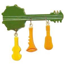Brooch--Vintage 20th C. Bakelite Banjo and Musical Instrument Dangles