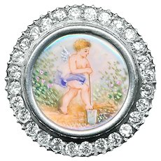 Button--19th C. Hand Painted Cherub Digging Garden Under Glass in Silver with Rhinestone Border