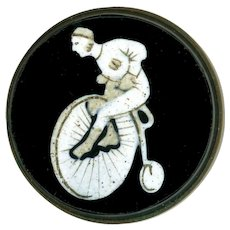 Button--Late 19th C. Black and White Glass Bicycle Man in Brass