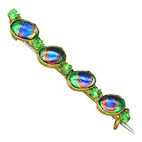 Brooch--Early 20th C. Bloodshot Peacock Eyes and Peridot Glass Jewels