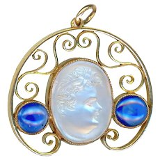 Pendant--18 Karat Gold and Adularescent Moonstone Cameo Child with Sapphires