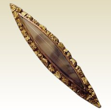 14Kt. Bar Pin with a Fossil Center and Alaskan Gold Nugget Trim