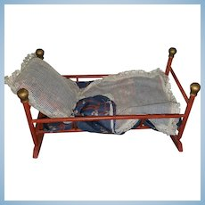 Antique Rocking Bed with Silk and Lace Bedding