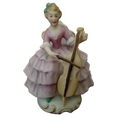 Vintage Signed ORLIK Bisque Porcelain Lady with Cello Figurine