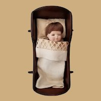 Signed Grace S. Putnam Bye Lo Baby Bisque Porcelain Doll, Cradle and Linens
