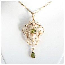 Circa 1900 Art Nouveau 15K lady's Peridot & Pearl Lavaliere Brooch