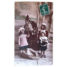 Tinted French Real Photo Postcard, Santa, Children & Bisque Doll, Happy New Year, 1912