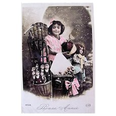 Tinted French Real Photo Postcard, Girl, Dolls and Toys, Happy New Year, Circa 1910s