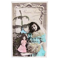 Tinted French Real Photo Postcard, Girl, Doll and ChristmasTree,  New Years Greetings, 1908