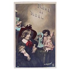 French Tinted Real Photo Postcard, Schoolgirl and 6 Dolls, Christmas Dream, Circa Early 1900s