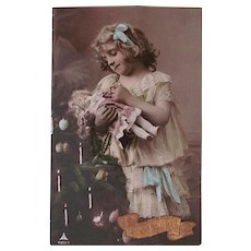 Tinted French Real Photo Postcard,  Girl, Bisque Doll and Christmas Tree, Postmarked 1908