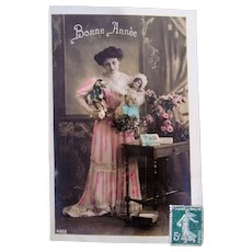 French Tinted Real Photo Postcard, Lady, Doll and Toys, Happy New Year, Postmarked 1910