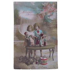 Tinted French Real Photo Postcard, Children, Dolls and Toys, Happy New Year, Circa 1910s