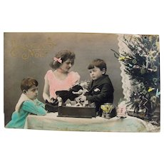 French Tinted Real Photo Postcard, Children, Doll, Toys and Christmas Tree, Circa Early 1900s