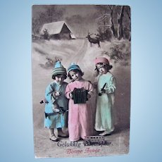 French Tinted Real Photo Postcard, French and Dutch Greeting, Children, Doll and Toys, Circa 1910s