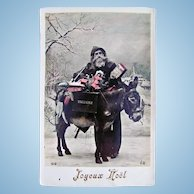 French Tinted Real Photo Postcard, Santa, Donkey, Doll and Toys, Circa 1910s