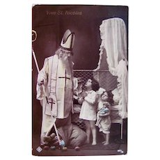 Tinted French Real Photo Postcard, Santa, Children, Dolls and Toys, Circa 1910s