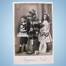 Tinted French Real Photo Postcard, Girl, Boy, Dolls, Toys & Tree, Circa 1910s