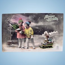 Tinted French Real Photo Postcard, Girl and Boy, Doll on Sled, Dated 1935