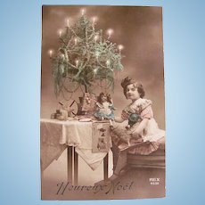 Tinted French Real Photo Postcard, Girl, Dolls, Toys and Tree, Circa 1910s