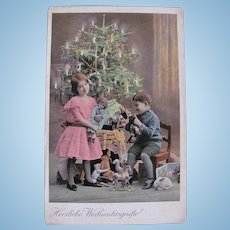 German Tinted Real Photo Postcard, Children, Dolls, Toys and Tree, Christmas, Dated 1917