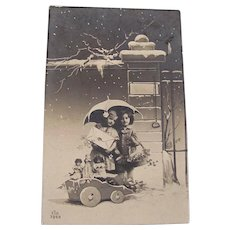 Italian Real Photo Postcard, 2 Children, 3 Dolls in Cart, Christmas, Dated 1912