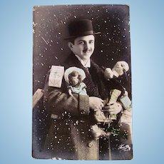 Tinted French Real Photo Postcard, Handsome Man, Doll, Toys and Gifts, Circa 1910s