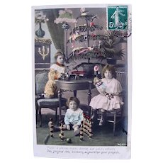 Tinted French Real Photo Postcard, 3 Children, Dolls, Toys and Tree, Postmarked 1907