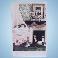 Tinted French Real Photo Postcard, 2 Children, 2 Dolls, Christmas, Postmarked 1906