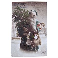 French Tinted Real Photo Postcard, Teal Robe Santa, Doll and Toys, Dated 1915